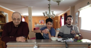 Dad, Shasta and Spencer, watching me cook. April 2015